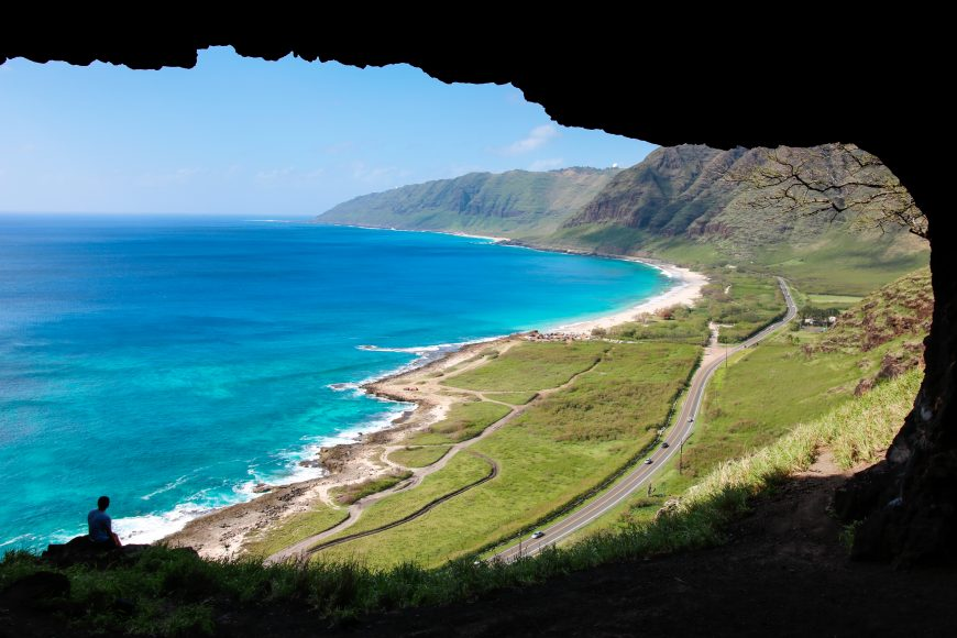 The Upper Makua Cave overlooks the end of Farrington Highway, the furthest you can go by car on the west side of Oahu. The hike to the cave, while short, is steep and the rocky path is dry and crumbly. However, the view is well worth the climb. Photograph by Nui Sabas.