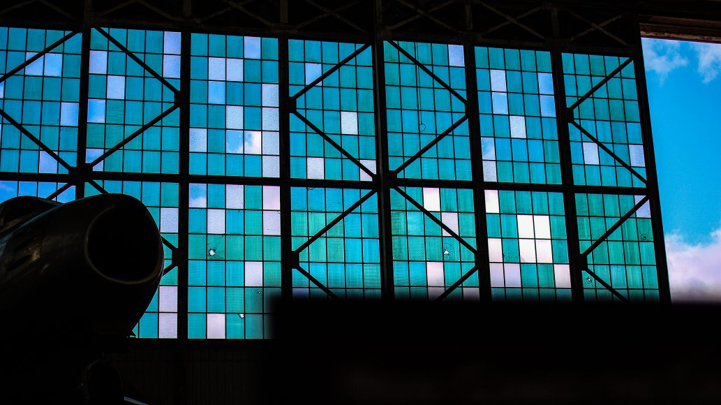 Bullet holes from the Japanese strike on Pearl Harbor still remain on Hangar 79's window panes.