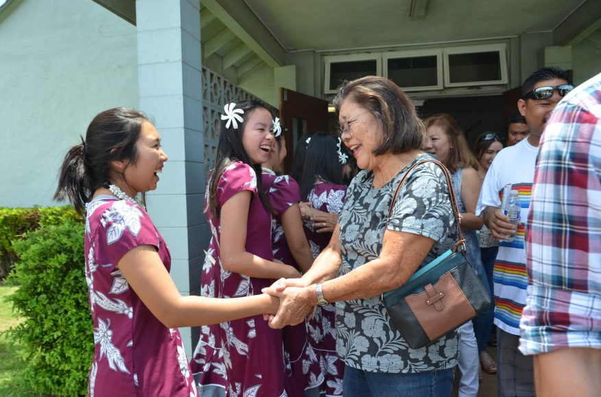Juniors Marcie Ann Johiro and Christianne Young greet Kahului Baptist Church members after their concert. Photograph by Todd Yokotake